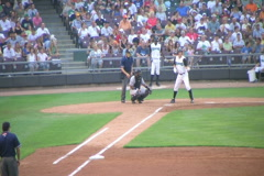 Batter Hits Fly Ball Stock Footage