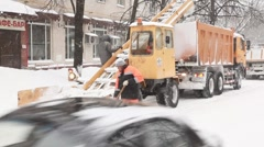 Municipal units with workers clean snow from street. Stock Footage