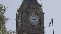 Big Ben with trees and flag Stock Footage