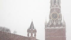Moscow Kremlin's Spasskaya Tower under showfall Stock Footage