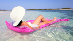 Relaxed Female Floating on Air Mattress Stock Footage