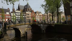 Streets, canals, bridges, buildings, boats in Amsterdam, Holland - stock footage