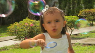 Small Girl Blowing Bubbles (HD) Stock Footage