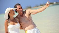 Caucasian Couple in Swimwear with Camera Stock Footage
