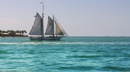 Schooner Passing by Sunset Key in Key West Stock Footage
