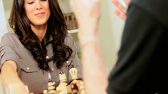 Young Female Playing Chess With a Friend Stock Footage