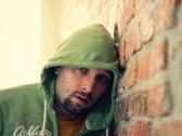 Sad man standing by the brick wall portrait NTSC Stock Footage