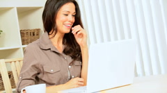 Brunette Girl Using Laptop for Online Internet Webchat - stock footage