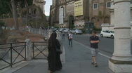 Nun walking up Rome hill (Long glidecam) Stock Footage