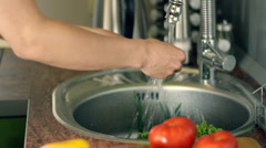 Female hands washing lettuce and onions in the sink HD Stock Footage
