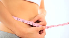 Slim Young Girl Checking Inch Loss - stock footage