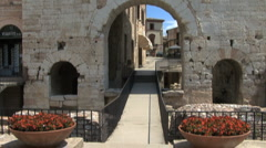 Italy Umbria Spello tilts up gate Stock Footage