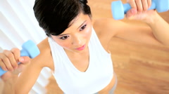 Young Asian Girl Lifting Hand Held Weights in Gym Stock Footage