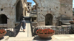 Italy Umbria Spello old woman gate Stock Footage