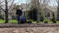 Farmer Tilling Garden HD-P 8074 - stock footage