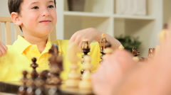 Little Caucasian Boy Playing Chess Stock Footage