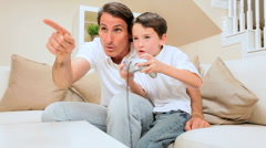 Father & Son Playing Games Console Stock Footage