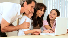 Family Using Laptop at Home - stock footage
