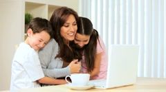 Family Looking at Laptop at Home Stock Footage