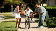 Stock Video Footage of African American Boy Learning to Ride a Bicycle