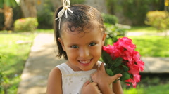 Girl Holding Gardenia Flowers (HD) Stock Footage