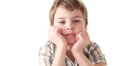 Boy supports the head in hands laughing and goggle Stock Footage