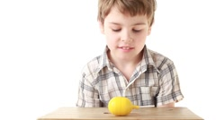 The boy with difficulty opening box with a toy Stock Footage