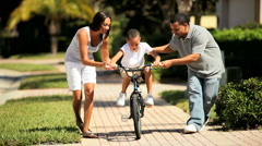 Boy Learning to Ride a Bicycle Stock Footage