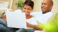 Attractive Ethnic Couple Using Laptop for Webchat Stock Footage