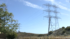 Wide Shot of Power Lines & Tower with Field Below - stock footage