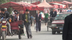 Kuqa bazaar in China, muslim minority, people shopping, traffic Stock Footage