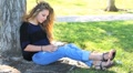 Beautiful Girl Reads Bible in Park HD Footage