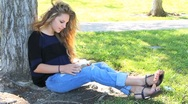 Beautiful Girl Reads Bible in Park Stock Footage
