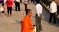 A Buddhist Young Monk and People visit Angkor Wat Temple, Cambodia, Khmer Temple Footage