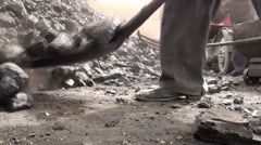 Shoveling coal by hand in Chinese village, poverty, China Stock Footage