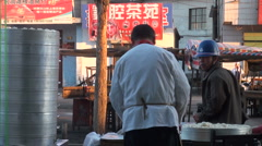 Selling steamed buns in the early morning, China - stock footage