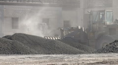 Shovels and dust in Chinese cement factory Stock Footage