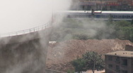 Stock Video Footage of Train passes behind coal fired powerplant in Chinese city