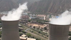 Two coal fired power stations in Lanzhou, a major city in Central China - stock footage
