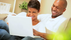 African American Couple Using Laptop for Webchat Stock Footage