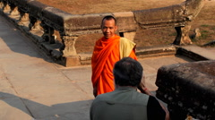 A Photographer Take a Shot of Young Buddhist Monk in Angkor Wat Temple, Cambodia Stock Footage