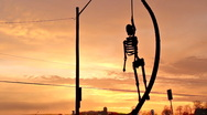 Hanging Skeleton Sunset 2 Stock Footage
