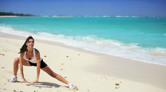 Healthy Female Doing Stretches on the Beach Stock Footage