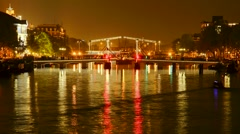 Skinny Bridge Amsterdam, Holland, night, time lapse - stock footage
