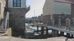 Harbour side apartments with external stairs and nautical hand rails Stock Footage