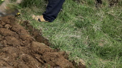 Man digging ground in his garden in spring time Stock Footage