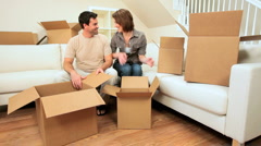 Young Couple Unpacking House Moving Cartons Stock Footage
