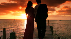 Couple in Evening Dress Watching Ocean Sunset Stock Footage