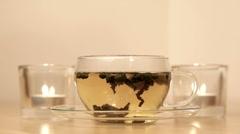 Woman inhales aroma of green tea - stock footage