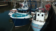 Commerical fishing boats moored in Whitby harbour Stock Footage